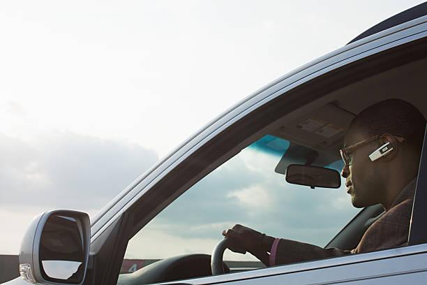 Man In Car With Earphone