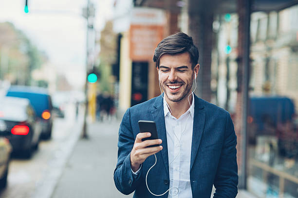 Man Using Phone And Headset