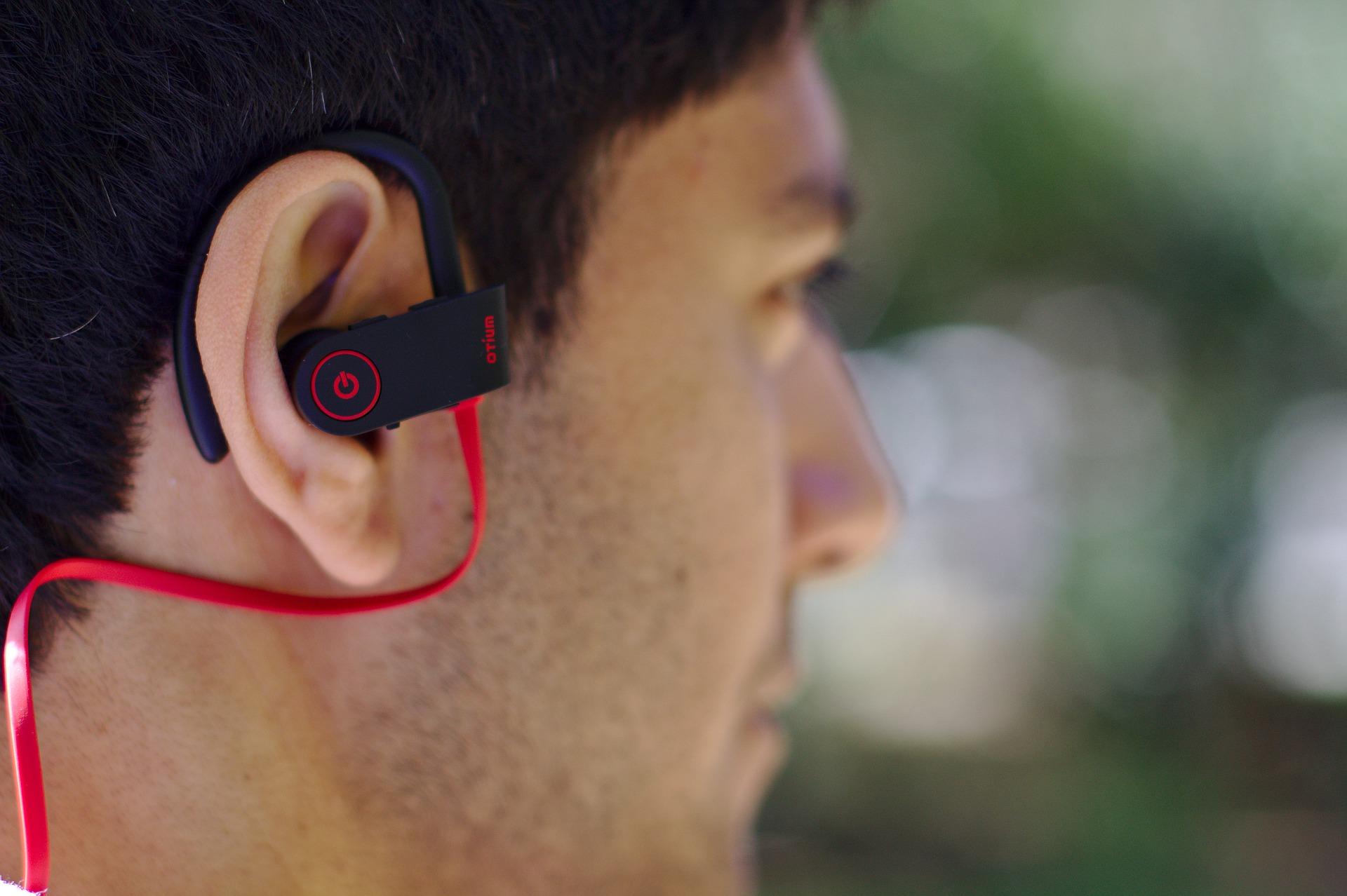 Man Wearing a Bluetooth Earpiece