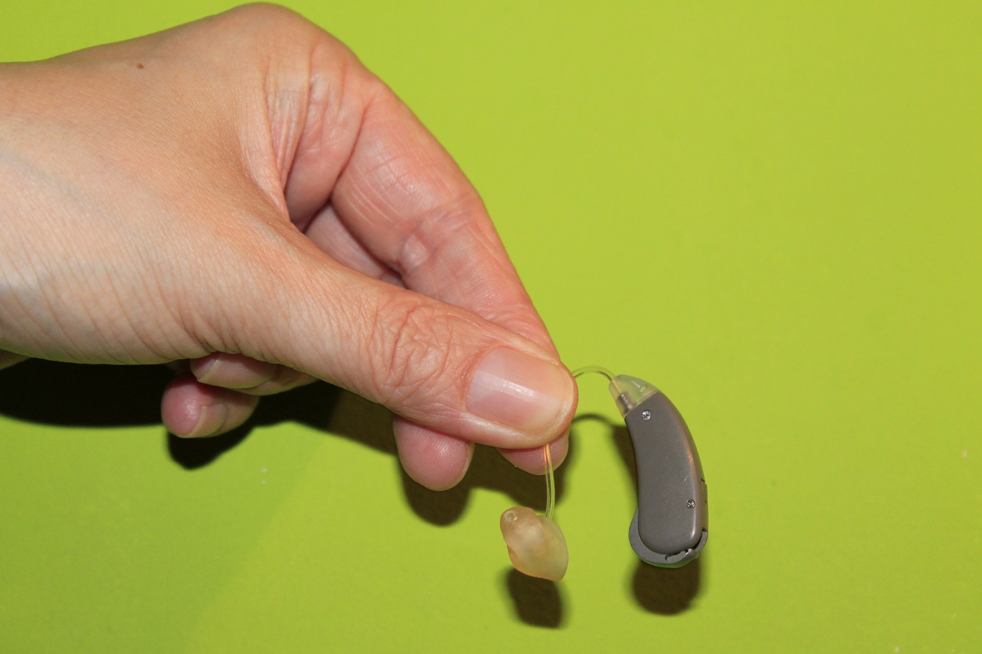Hand holding a Hearing Aid